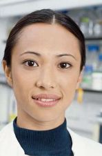 Smiling female researcher in lab