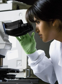 Female Scientist at Microscope