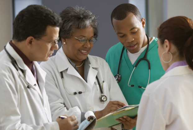 healthcare professionals consulting patient file